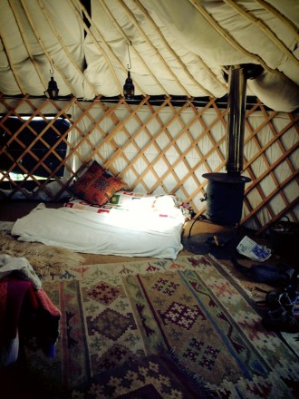 yurt interior woodburning stove